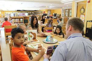 Dr. Seinfeld meets with second graders at A Taste of Dr. Seinfeld's Community Book Club