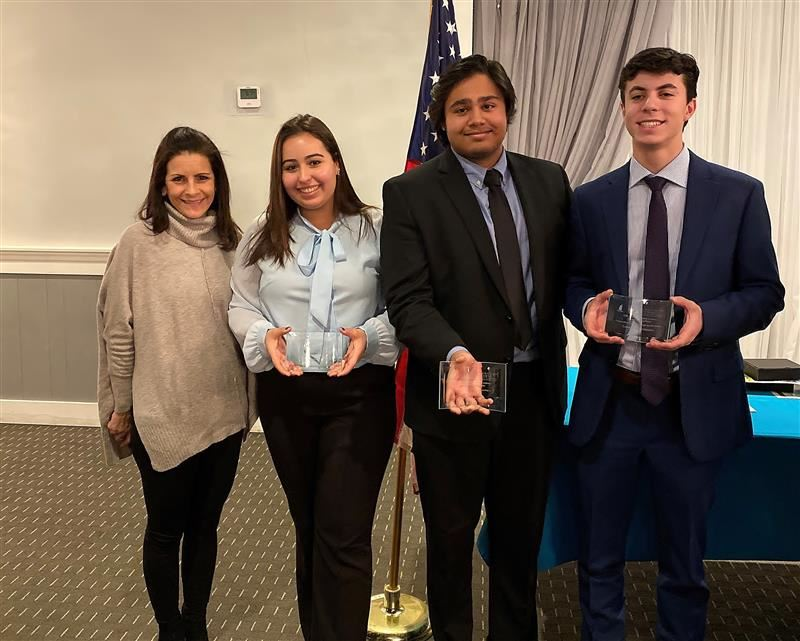 students show awards they won in business competition