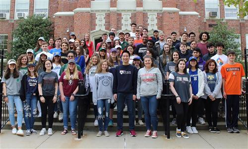 college decision day-seniors in college shirts
