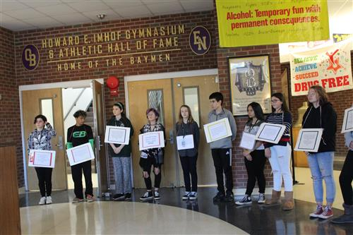 students with placards for grim reaper day