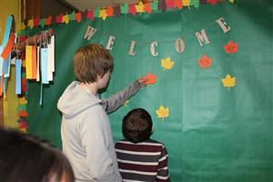 students add to the welcome wall