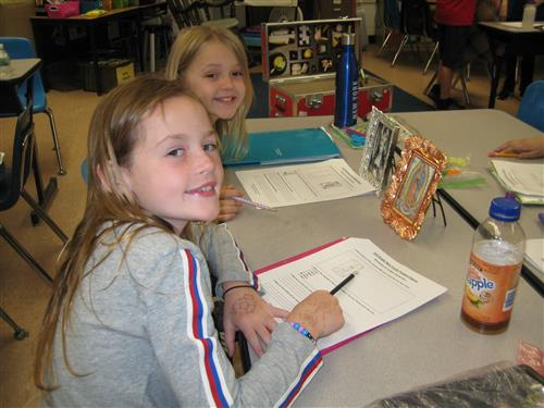 students complete inquiry books