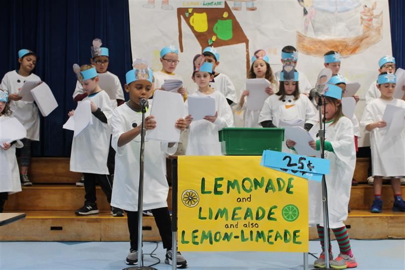 second graders perform a Readers' Theater on the book, Lemonade in Winter