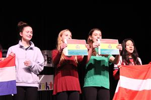 students perform with flags at international night