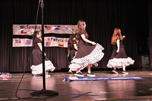 students dance with flowy skirts
