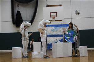 polar bear with mother earth characters in Cool the Earth play
