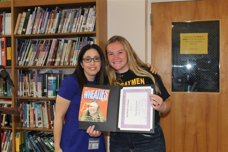 Reilly Iles received a Breakfast of Champions award from social studies teacher Ms. Lauren Harnick