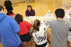 students talk to a veterinarian at career day