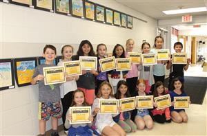 Vernon 4th graders hold certificates for being winners in a bird sign art contest