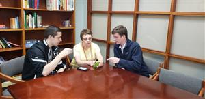 Michael McGee teaches senior how to use iphone