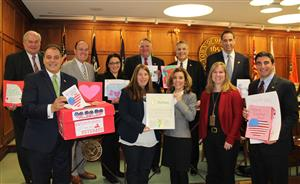 Town Board with Vernon Principal displaying Valentines for Vets