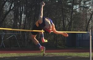 track athlete clears pole