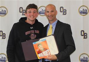Mr. Trentowski presents Breakfast of Champions award to Anthony Reilly