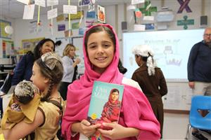 3rd graders dressed as historical figures for wax museum presention