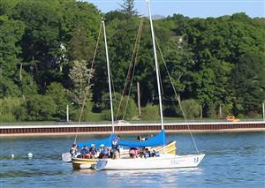 students are ferried to the sailboats
