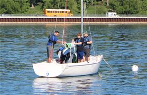 physics students learn how to raise the sail on a sailboat