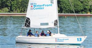a third boat of students sets sail