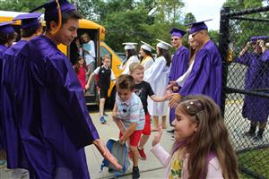 salutatorian fives Roosevelt student a high five