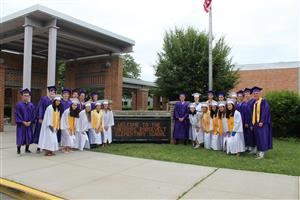 seniors in cap and gown visit Roosevelt
