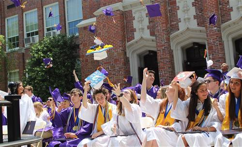 graduates throw caps in the air 2019