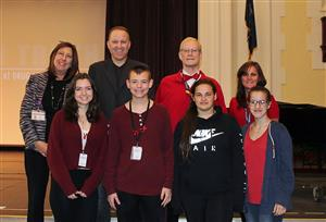 Teen Truth speaker poses with SADD members, social workers and principal