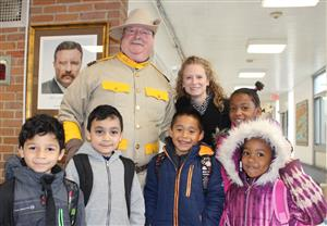 Roosevelt students pose with Mr. Michael O'Neill who dressed as Theodore Roosevelt for his birthday celebration