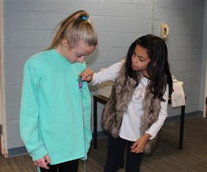 students measure each other