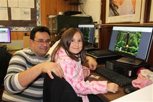 student with parent at hour of code
