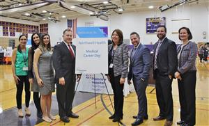 OBHS administrators and Northwell Health staff pose by Career Day sign