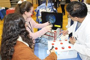 students learn to maneuver laprascopic equipment at Northwell Health Career Fair 2018