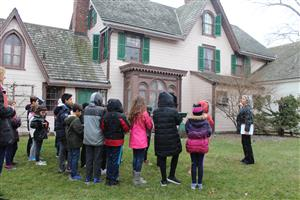 students tour the outside of the house