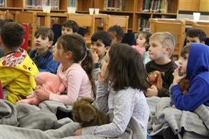Roosevelt students react to a story that is being read to them