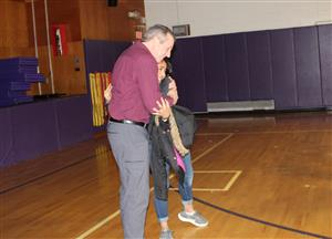 Mr. Halligan gets a hug from a student after his presentation on bullying and suicide