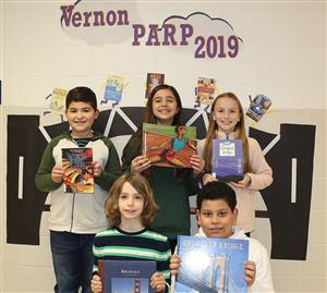 Vernon PARP student hold books