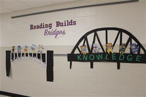 Reading Builds Bridges to Knowledge mural in Vernon hallway