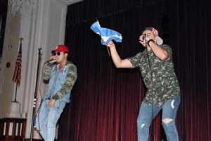 Two students perform a rap song at International Night