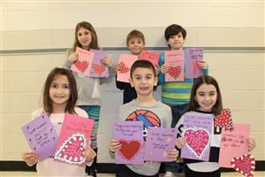 Vernon students with the valentines they made for veterans