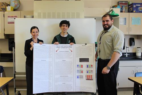 Thomas Coor with science research project. He won honorable mention at LISEF.