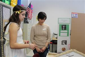 a student presents her project on Cleopatra
