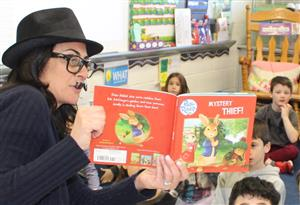 PARP volunteer reads a mystery to students