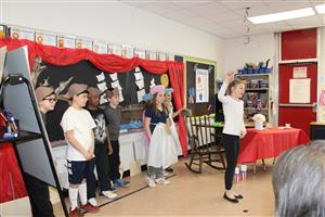 students act in play about american revolution