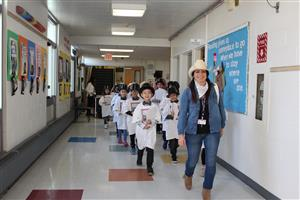Ms. Patti and her class walk the hallway