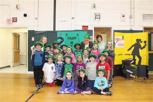 Principal with students after she was challenged to Irish Step Dance