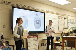 eighth graders present their t-shirt designs