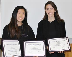 two senior receive certificates for their artwork