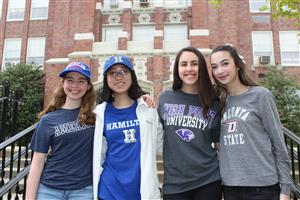 students wearing college caps and shirts