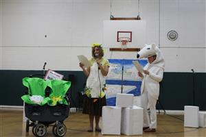 teacher perform play for Earth Day