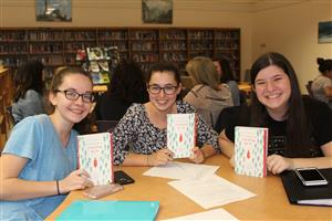 students with book discussed in book club