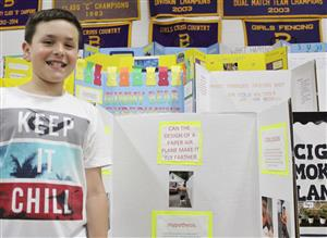 fifth grader with science project