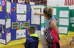 mother and son at district science fair